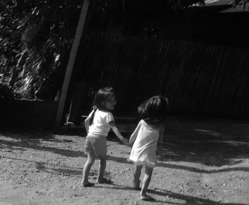 children holding hands and walking together