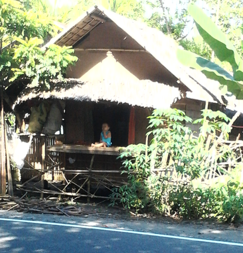 a child in a hut